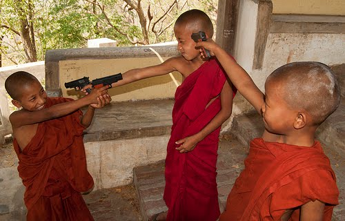 Monasticsnovices-playing-with-toy-guns-se-asia